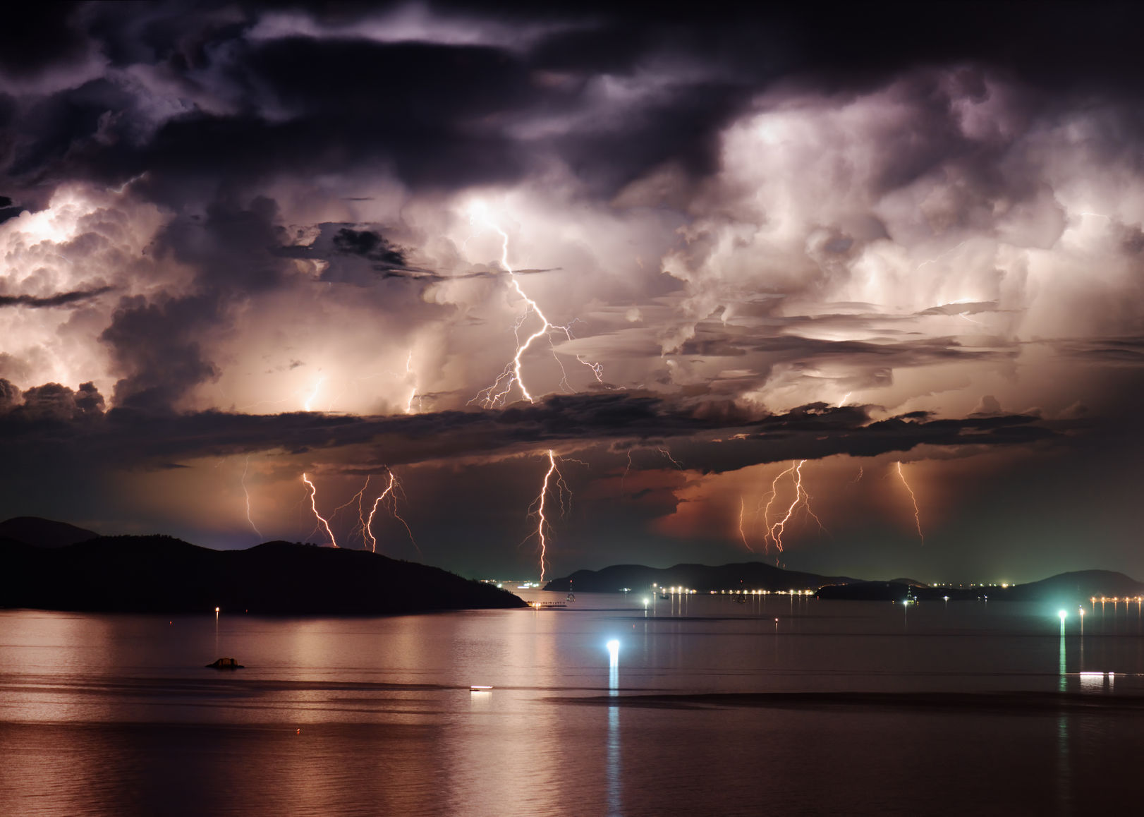 41789107 - beautiful view of dramatic stormy sky and lightning over nha trang bay of south china sea in khanh hoa province at night in vietnam. nha trang city is a popular tourist destination of asia.